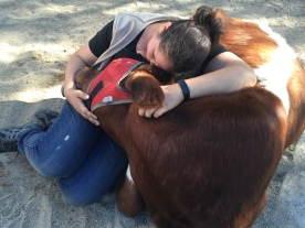 Volunteer Val cuddles with sweet Sage.
