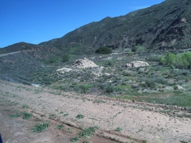Debris strewn across the canyon floor as seen from the road leading to the dam site.